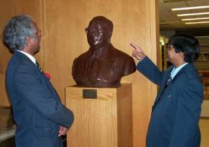 Balchandra Mungekar, vice chancellor of Bombay University, points to a statue of B.R. Ambedkar at Columbia University