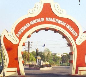 Gate of the renamed university and statue of Dr. Ambedkar in distance