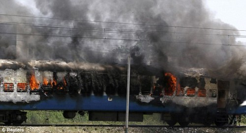 A passenger train burns in Jalandhar, in the northern Indian state of Punjab as thousands of protesters take to the streets after an attack in a Sikh temple in Austria. (Source Daily Mail)